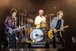 A rock band performs on a stage. Its the Rolling Stones.
