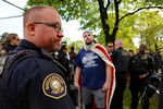 """Jeremy Joseph Christian (center wearing American flag), the man accused of a fatal stabbing on the MAX train, attended the April 29 """"March for Free Speech"""" on 82nd Avenue."""