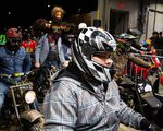 Costumed racers line up in the pits at the One Moto at Veterans Memorial Coliseum in Portland, Ore.