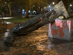 """Protesters in Portland toppled multiple statues, including this one of President Abraham Lincoln, on Sunday, Oct. 11, 2020, during an event they called """"Indigenous People's Day of Rage."""""""