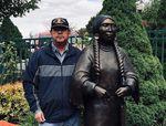 "Artist Doug Hyde with ""etweyé·wise"" (literally, ""I return from a hard journey"") on Main Street in Joseph, Oregon."