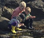 Distinguished Professor Jane Lubchenco of Oregon State University tide-pooling with her grandchildren Elin and Alistair Menge on the central Oregon coast.