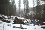 Jay Hennigan, president of the Breitenbush Cabin Owners Association, looks at some of the rubble remaining where his cabin once stood in Breitenbush, March 5, 2021. The cabin was destroyed by the Beachie Creek and Lionshead fires in 2020.