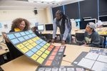 Students studying Animation and Motion Graphics at Bowie State University share their work with Professor Tewodross Melchishua Williams.