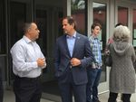 Republican gubernatorial candidate Knute Buehler (center, blue suit) speaks with supporters and students outside Davis Elementary School in Gresham on June 28, 2018.