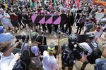 """Far-right demonstrators and counter-protestors face off at the entrance to Emancipation Park in Charlottesville, Va., during the """"Unite the Right"""" rally in August 2017."""