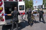 Salem Fire Department paramedics and employees of Falck Northwest ambulances respond to a heat exposure call during a heat wave, Saturday, June 26, 2021, in Salem, Ore.