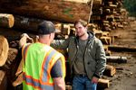 Alek Skarlatos, right, speaks with a Douglas County woodworker during a campaign stop on Feb. 6, 2020.