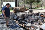 Dwayne Canfield, interim director of the Opal Creek Ancient Forest Center, walks among the remains of a building that burned in the Beachie Creek Fire last year.
