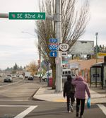 Pedestrians cross the busy intersection of SE 82nd Avenue and SE Division Street on Sunday, Nov. 19, 2017.