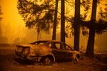 The charred husk of a car in a neighborhood burned in the Santiam Fire near Gates, Ore., Sept. 9, 2020. Fires around Oregon could become the deadliest, costliest in state history.
