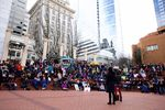 People gather for a #MeToo event at Pioneer Courthouse Square.