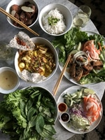 One of food journalist Samantha Bakall's favorite Vietnamese restaurants in Portland is Mehka Noodle. Pictured here is the mi quang — a turmeric-infused seafood and pork soup from Central Vietnam —  lettuce wraps, and bun cha Hanoi.
