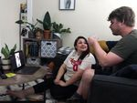 Maggie Sewell and Ethan Johnson watch Joshua Madrid's virtual happy hour on Facebook Live on Saturday, May 9, 2020, in Portland, Ore.