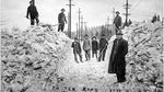 Road crew with shovels stand on foster road after clearing snow off street during 1916 winter snowfall, Foster Road in SE Portland, Jan. 21. 1916.