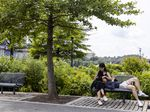 People relax at the Georgetown Waterfront Park on Monday in Washington, D.C. While pandemic restrictions have been lifted for much of the country, the Delta variant of COVID-19 is hospitalizing thousands of people in the U.S. who have so far not gotten a vaccine.