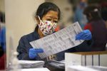 An election worker sorts mail-in ballots at the Multnomah County Duniway-Lovejoy Elections Building Monday, Nov. 2, 2020, in Portland, Ore. (AP Photo/Marcio Jose Sanchez)
