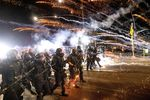 Police use chemical irritants and crowd control munitions to disperse protesters during a downtown Portland demonstration in September 2020.