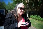 Teresa Christian uses a phone app designed to help her experience the eclipse on Aug. 21 2017.