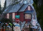 A quiet morning, Dec. 10, 2020, at the red house on North Mississippi in Portland, where protesters have been camped out at the home of the Kinneys, a Black and Indigenous family that has lived there for over six decades and is facing eviction. North Mississippi is blocked in both directions.