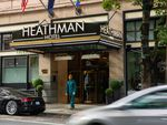 A bellhop at the Heathman Hotel walks out to greet a customer on Tuesday, Oct. 15, 2019, in downtown Portland, Ore. The Heathman is part of Gordon Sondland's Provenance Hotels chain.