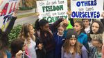 Oregon City High School students carried signs to the sidewalk next to the school after a meeting inside, about recently-circulated racist messages at the school.