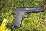 Police say Robert Delgado had a replica handgun when an officer shot and killed him.