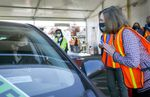 Annalisa Birt, left, talks with Gov. Kate Brown after Birt received a COVID-19 vaccination at a drive-thru vaccination clinic at Portland International Airport, April 9, 2021.
