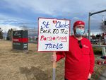X-ray technician Chriss Curry pickets at St. Charles Medical Center in Bend on Feb. 1, 2021. He took a substantial pay cut in order to work at the hospital and move back to his hometown three years ago.