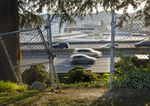 The I-5 freeway is seen through the fencing at the back of Harriet Tubman Middle School in North Portland, April 9, 2021. Gov. Kate Brown supports moving the school.