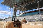 Trick roper Rider Kiesner nonchalantly twirls a lasso around himself as he rehearses for opening night of the Happy Canyon show at the Pendleton Round-up.
