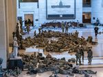 Hundreds of National Guard troops hold inside the Capitol Visitor's Center to reinforce security at the Capitol in Washington.