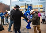 Rabbi Moshe Wilhelm, left, stands with a dreidel mascot at the first night of Hanukkah event put on by Chabad of Oregon at Director Park on Sunday, Dec. 22, 2019, in Portland, Ore.