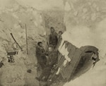 Whaling crew members trapped by Arctic ice blasting a wreck for firewood.