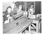 Women work on a line of grenades at the Umatilla Chemical Weapons Depot during World War II.