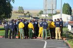 Firefighting crews assemble to contain the Substation Fire burning east of The Dalles, Ore.