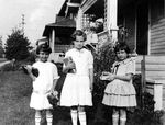 The first day of first grade for little Beverly (far right)