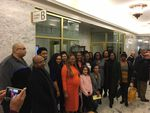 Suppporters of a bill to ban race-based hair discrimination pose for a photo following a public hearing in Olympia on Tuesday.