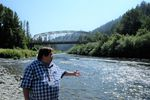 Karuk Tribal Councilmember Troy Hockaday stands at the junction of Indian Creek and the Klamath River