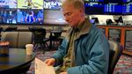 Football and basketball fan David Salisbury studying the daily odds at the Chinook Winds Casino sportsbook in Lincoln City, Oregon.