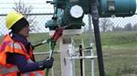 Annette Klapstein of Seattle cuts a chain on an Enbridge oil pipeline in Minnesota in October 2016.
