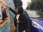 Ana Mendoza unplugs a Honda Fit EV at a low-income apartment complex in Northeast Portland's Cully neighborhood. It's one of three vehicles in a new car-sharing program organized by Hacienda Community Development Corporation and the electric car advocacy group Forth.
