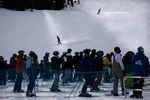 Skiers and snowboarders wait in line at Mt. Bachelor ski resort outside Bend, Ore., Monday, Dec. 7, 2020.