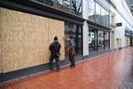Downtown Portland businesses ready their storefronts for the expected large-scale protests, Jan. 20, 2017.