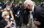 Democratic presidential candidate Joe Biden greets Maria Fisher, 90, whose son Andrew Fisher was killed in the World Trade Center north tower in New York on Friday.