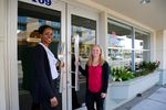 Burgerville's Liz Graham, director of human resources, and Beth Brewer, senior vice president of operations, in front of Burgerville's corporate offices in Vancouver, Washington.