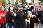 """Joe Biggs, a member of the Proud Boys and former staffer at the conspiracy site Infowars, speaks to white supremacist demonstrators in Portland, Ore., Saturday, Aug. 17, 2019. Biggs organized the rally to """"end antifa,"""" referencing antifascist protesters who often show up to counter white supremacist groups in Portland."""