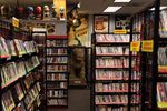 """Movie Madness's maze of aisles is stuffed with more than 84,000 films of all stripes, as well as film memorabilia like the Fu Dog Stature from the Xanadu set in """"Citizen Kane."""""""