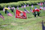 A U.S. Marine Corps. flag flies over the grave of a fallen Marine at the Willamette National Cemetery in 2016.
