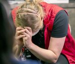 Julie Kleese, RN, cries after sharing her experiences as an ICU nurse at OHSU Hospital in Portland, Ore., Aug. 18, 2021.
